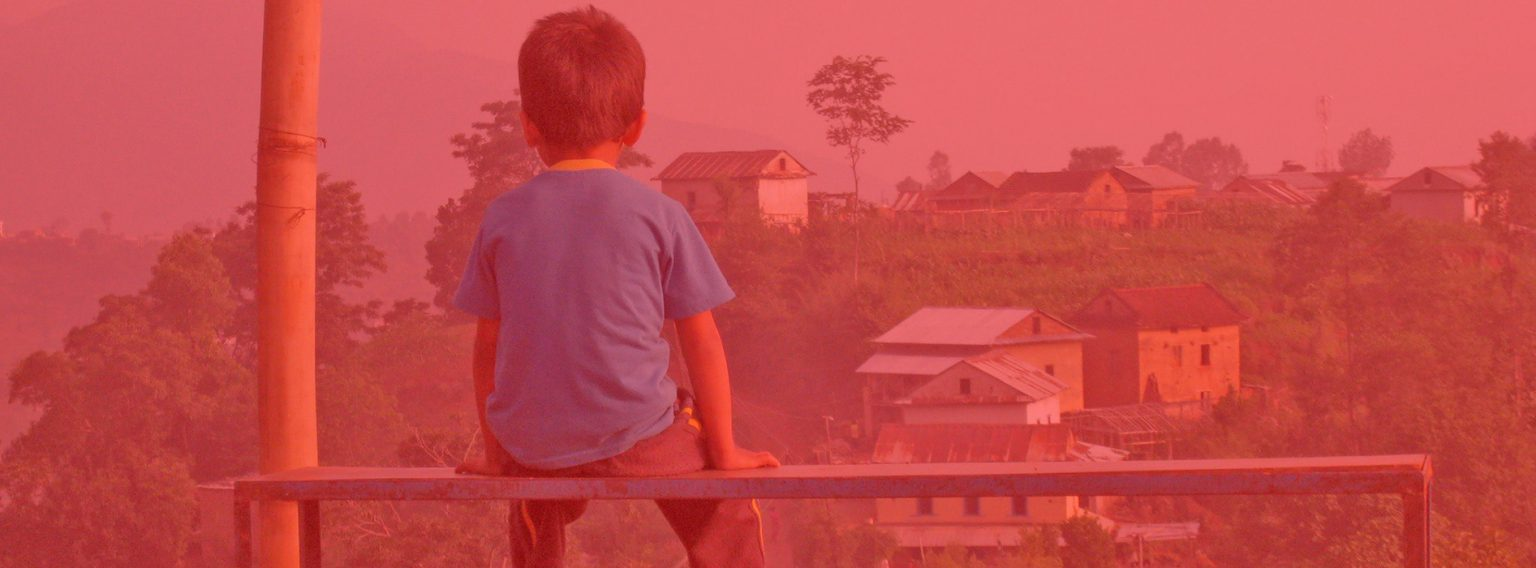 Child looking over a village