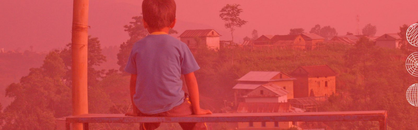 Child looking out at a village
